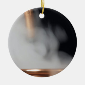 copper pipe of a distillery with steam. ceramic ornament