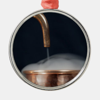 copper pipe of a distillery with steam. metal ornament