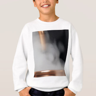 copper pipe of a distillery with steam. sweatshirt