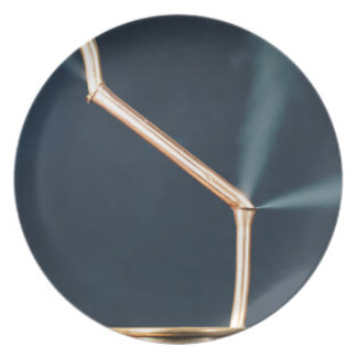 Copper pipes with a leak and steam. melamine plate