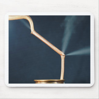 Copper pipes with a leak and steam. mouse pad