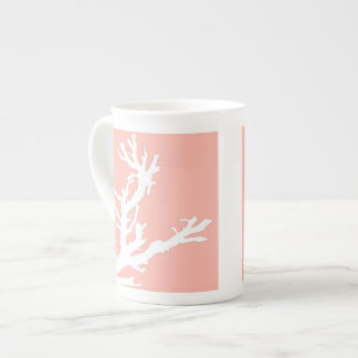 Coral branch - white on coral pink tea cup