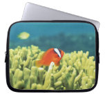 Coral reef teeming with tropical fish laptop sleeve