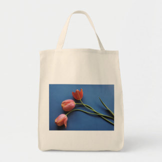coral tulips on blue grocery tote bag