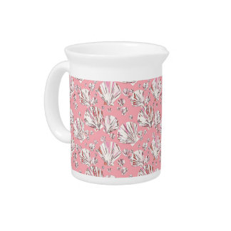 Coral, white and pink sea shells, pink background pitcher