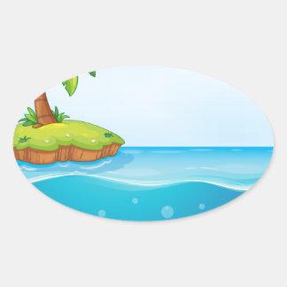 coral y palmera en la isla pegatina ovalada