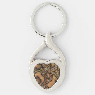 Corazón abstracto del diseño de la tinta de la llavero plateado en forma de corazón
