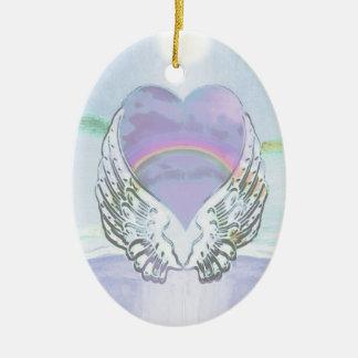 Corazón, alas del ángel y océano adorno ovalado de cerámica