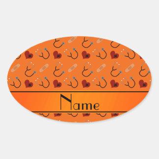 Corazón anaranjado conocido personalizado del pegatina ovalada