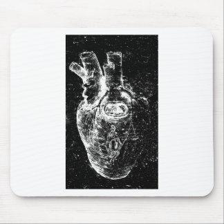 Corazón anatómico con el ojo de la cerradura tapetes de ratones