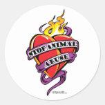 Corazón animal del tatuaje del abuso pegatinas redondas