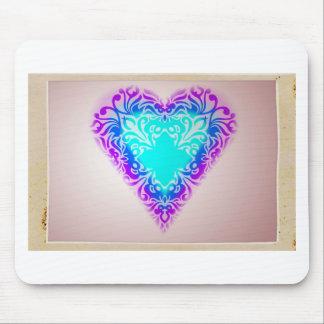 Corazón azul que brilla intensamente alfombrillas de ratón