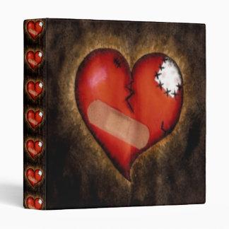 Corazón-Carpeta quebrada de la reparación