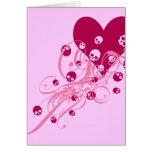 Corazón con los cráneos rosados y los remolinos felicitacion