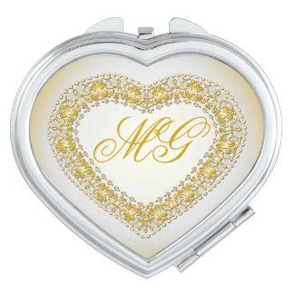 Corazón con monograma del latón y del oro - espejo espejo de viaje