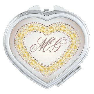 Corazón con monograma del oro y del cobre - espejo espejos de viaje