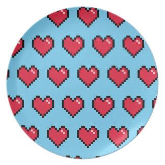 Corazón de 8 bits del pixel del rojo azul plato de cena