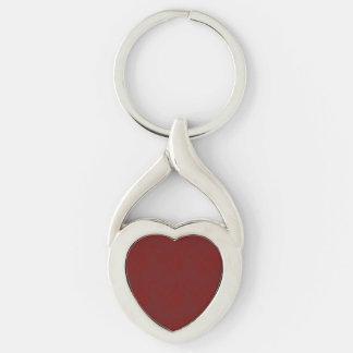 Corazón de color rojo oscuro de la textura llavero plateado en forma de corazón