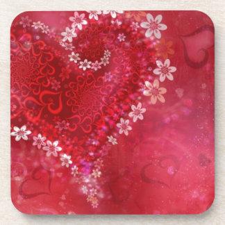 Corazón de la flor del amor posavaso