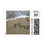 Corazón de la playa de la postal sello