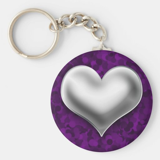 Corazón de plata hinchado en púrpura llaveros
