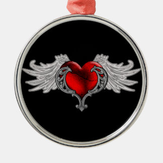 Corazón del gótico con las alas del ángel adorno navideño redondo de metal