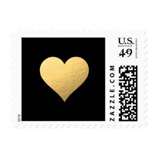 Corazón del oro con los sellos negros del fondo