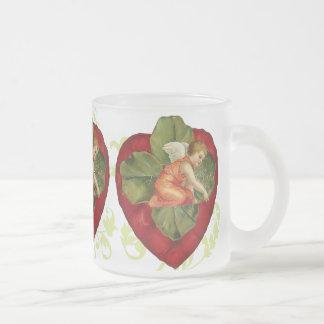 Corazón del Victorian y taza del trébol