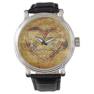 Corazón doble del infinito del símbolo bicolor relojes de pulsera