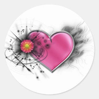 Corazón elegante del eje de balancín con la cruz pegatina redonda