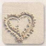 Corazón en arena posavaso