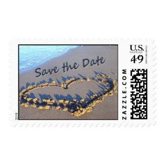 Corazón en la reserva de la arena los sellos de la