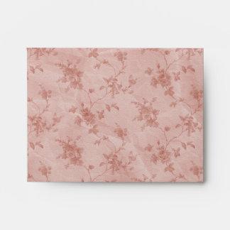 corazón floral de la primavera y del cordón rosado