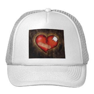 Corazón-gorra del corazón quebrado de la reparació