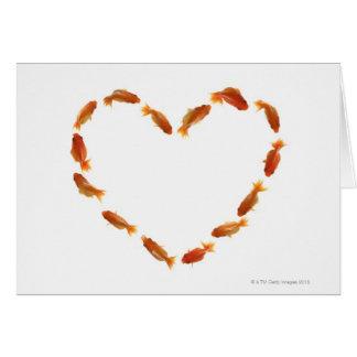 Corazón hecho con los goldfishes felicitación