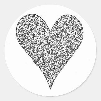 Corazón, hecho de caras pegatinas redondas