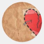 corazón herido etiquetas redondas