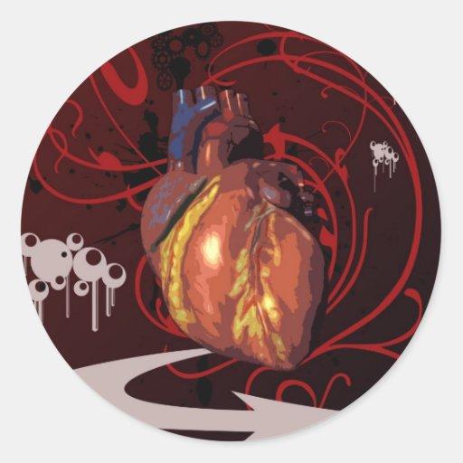 Corazón humano pegatina redonda