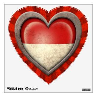 Corazón indonesio envejecido de la bandera con los vinilo decorativo