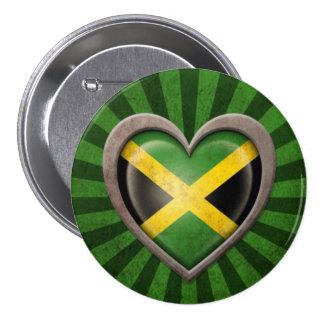 Corazón jamaicano envejecido de la bandera con los pin