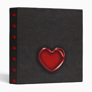 """Corazón metálico rojo en el cuero negro carpeta 1"""""""