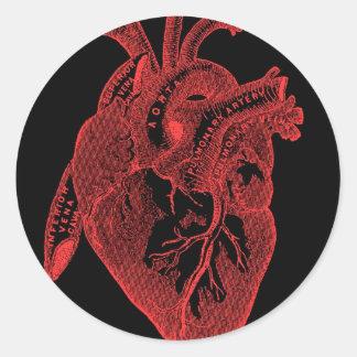 Corazón negro anatómico pegatina redonda