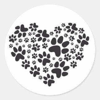 corazón negro con las patas, modelo animal del pegatina redonda