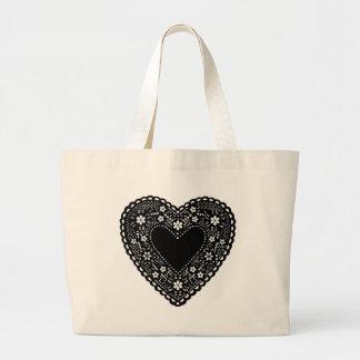 Corazón negro del cordón bolsa