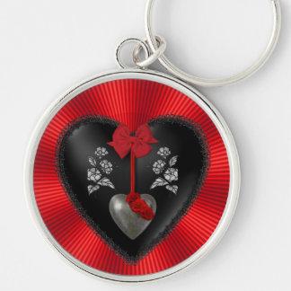 Corazón negro del satén y de la plata llavero redondo plateado