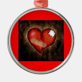 Corazón-ornamento quebrado de la reparación adorno
