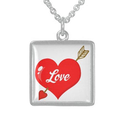 Corazón perforado con la flecha y el texto joyerias