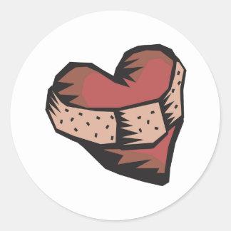 Corazón reparado pegatina redonda