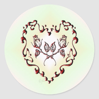 Corazón rojo de la tinta pegatina redonda