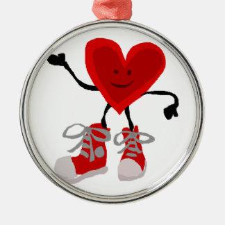 Corazón rojo divertido en dibujo animado de las adorno navideño redondo de metal